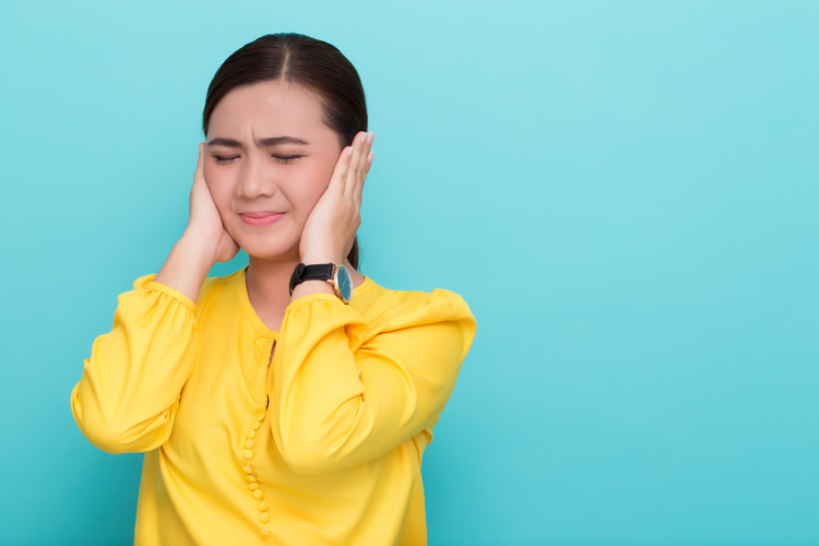 Asian woman close her ears