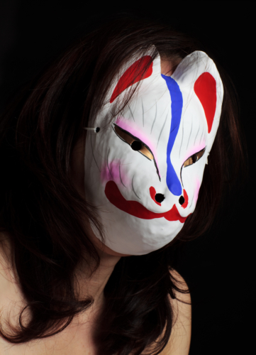 The woman wearing a mask of Fox