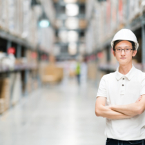 Asian engineer or technician, warehouse blur background