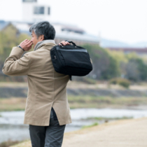 Businessman commuting by the river.