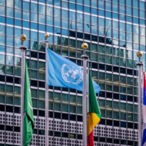 NEW YORK, USA - December 08, 2016: World and UN Flags in front  at United Nations Headquarters in Manhattan