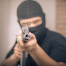 Concept about terrorism with terrorist sniper shooting with his weapon