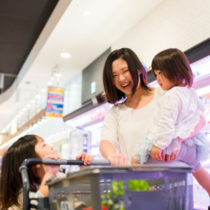 Single mother with two kids shopping in a supermarket. Osaka, Japan. June 2016