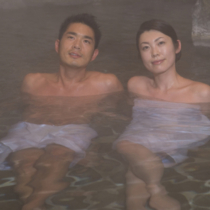 Man and woman in hot spring