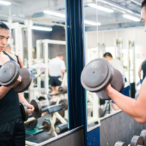 Mid adult male lifting weights in the gym. Osaka, Japan. May 2016