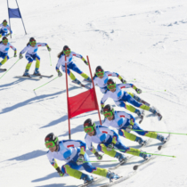 Multiple image of young women during the giant slalom