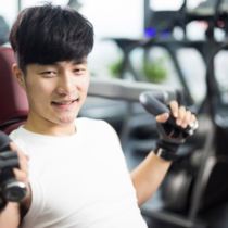 young handsome asian man works out in modern gynm