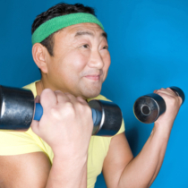Man lifting up dumbbell