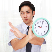 Asian businessman with a clock