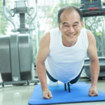 Asian senior man doing push up