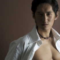 A cool asian model in an open white shirt