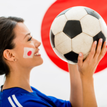 Football fan from Japan holding a ball